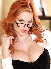 Curly-haired redhead milf Tarra White shows off her trimmed snatch and boobs