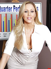 Smiling milf Julia Ann shows her big boobies and accurate trimmed pussy