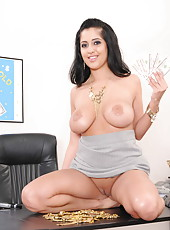Pretty smiling mature secretary Kimber Kay gets naked and touches her shaved puss