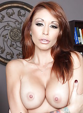 Redhead Monique Alexander shows her nice big boobies and shaved pussy