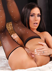 Spicy secretary milf Jessica Jaymes shows off her long legs and high heels