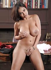 Stunning tanned mature Priya Anjali Rai shows off her big boobies
