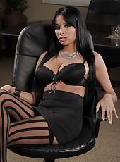 Slender secretary milf Anissa Kate is getting naked in her stockings