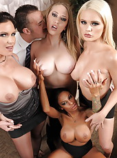 Horny as hell ladies with big boobies are fucking with their lovely boss on a sofa