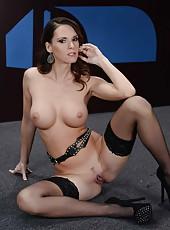 Naughty brunette MILF Jennifer Dark  revealing her big tits and ass