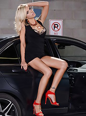 Hot MILF Nina Elle prefers to show off her magnificent body near a nice car