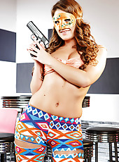 Pretty babe Abby Cross posing with a gun and wearing a mask in a odd room