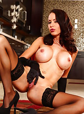 Raunchy and extremely hot MILF McKenzie Lee doing a spectacular striptease