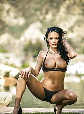 Remarkable brunette MILF Alektra Blue showing her huge boobs outdoors