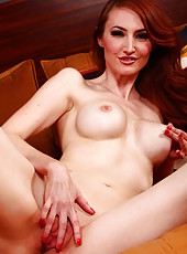 Pretty redhead MILF Kendra James showing how she masturbates her pussy