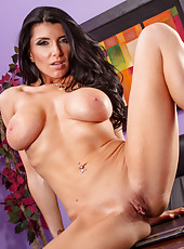 Prepossessing MILF Romi Rain revealing her amazing tits and her ass