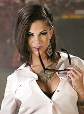 Stunning MILF Bonnie Rotten showing her over tattooed body and masturbating