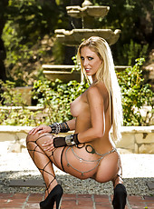 Big titted blonde milf Cherie Deville demonstrates an amazing outdoor scene