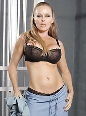 Fabulous milf named Dyanna Lauren undresses and shows her huge boobs