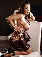 Brunette milf Lisa Ann demonstrates her huge boobs and masturbates