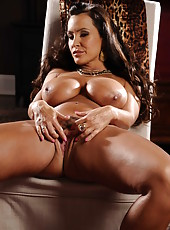 Brunette milf Lisa Ann demonstrates her huge boobs and masturbates