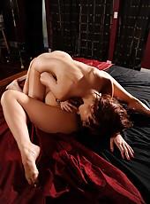 Asian brunette babe Asa Akira has sweet time with redhead milf Zoe Voss