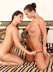 Awesome lesbian milfs Cindy Dollar and Eve Angel plunging a toy in the ass
