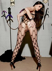 Fantastic brunette babe Georgia Jones in poses astonishing pantyhose