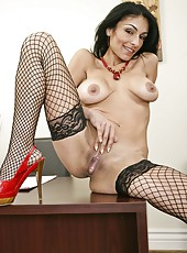 Dangerously hot milf Persia Pele shows off her body in stockings and high heels