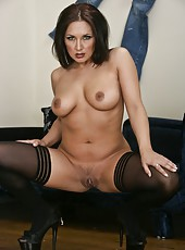 Fabulous milf Zoe Britton is showing her ass in sexy black stockings
