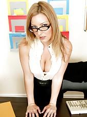 Blonde milf secretary Avy Scott is showing her big tits in office