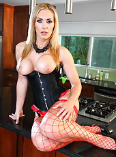 Sexy blonde milf in red fishnet stockings Tanya Tate shows us her ass and pussy