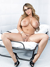 Jolly babe Holly Halston playing with her melons and tasting a wiener