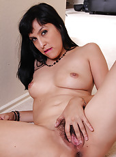 Cute and elegant 32 year old Betty Green showing off her furry pussy