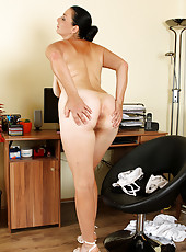 Hot brunette secretary Leona Sweet unleashes her massive mams