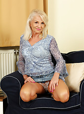 47 year old Inez shows off her sexy mature body in the livingroom