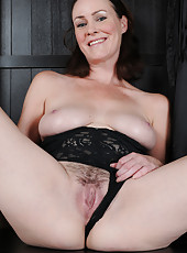 Popular brunette MILF Veronica Snow pulls aside lingerie to show all