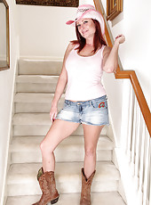 Redheaded MILF Shelly Jones strips off her denim shorts on the stairs