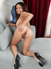 Petite and 32 year old Vera Waang showing off her big clit on the couch