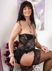 45 year old lelani Tizzie looking hot in her stockings and lingerie