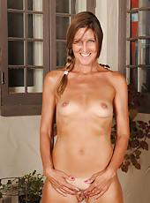 Thin 50 year old LA Valkenberg slips out of her short denim miniskirt