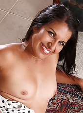 Exotic 41 year old Saffron LeBlanc poses and spreads in the foyer