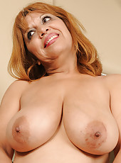 47 year old and busty Marissa from AllOver30 tugs at her pussy lips