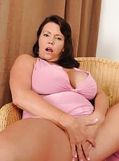 39 year old Angelica Sin lets her massive titties free for you to see
