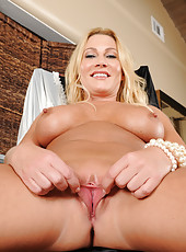 41 year old Jennifer Best slips off her lacey pink panties and spreads