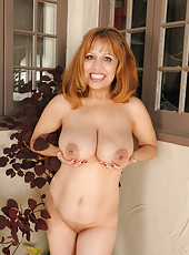 Exotic 47 year old Marissa from AllOver30 doing a little naked gardening