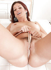 Mature housewife Salicia Silver showing off her furry beaver in here
