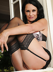 63 year old brunette Rita Daniels spreads her mature ass in stockings