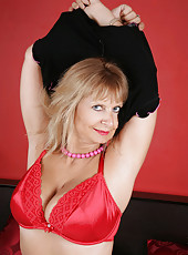 Gorgeous Anilos Alex spreads her legs wide open and flaunts her cleavage wearing her red bra