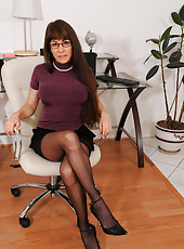 Naughty secretary in glasses peels off her office attire to flaunt her body