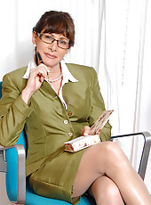Seductive secretary flaunts her bra and panties under her business attire