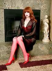 Hypnotic red headed cougar teases us in her sheer red lingerie