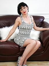 Classy milf Barbie Stroker shows off long silky legs