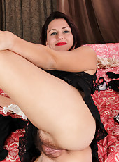 Betsy Long wears seductive lingerie and plays with her pink hairy pussy
