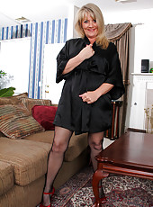 Alluring milf Bobbie Jones in her silk robe and fishnet body stocking